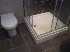 Image of sealant application around shower tray